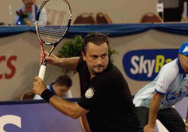 Henri Leconte preparing
